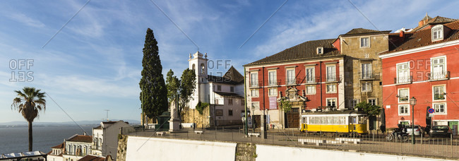 May 15, 2015: Church Santa Luzia at Largo das Portas do Sol and old tram, Alfama district