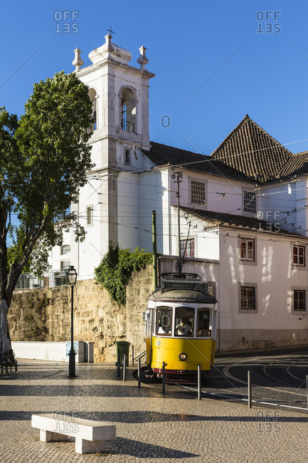 May 17, 2015: Church Santa Luzia at Largo das Portas do Sol and old tram, Alfama district