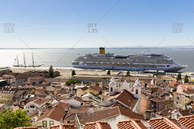 May 16, 2015: View from Miradouro de Santa Luzia on the rooftops of the Alfama district and the Cruise Ship Costa Favolosa, Largo das Portas do Sol