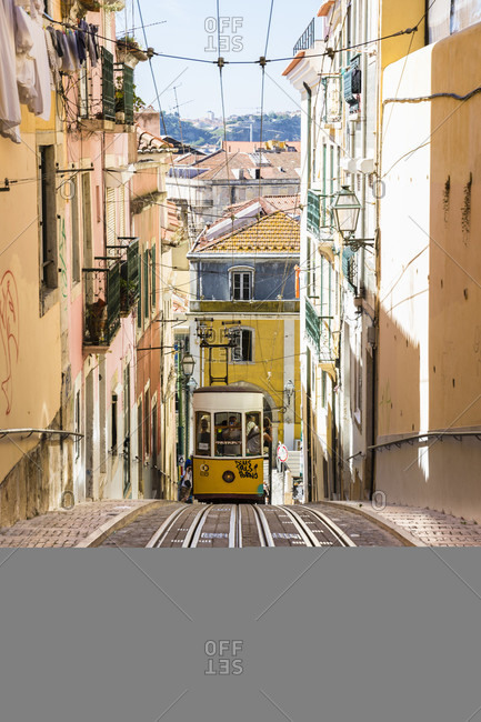May 16, 2015: Elevator da Bica cable car on a little steep street in the Chiado district