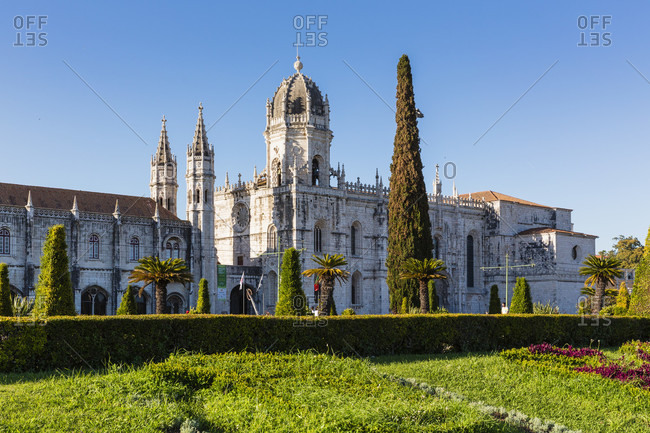 May 16, 2015: Saint Mary's church and garden as part of the Jeronimos monastery, 16th century architecture in typical Manueline style, Belem