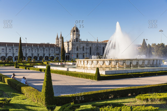 May 16, 2015: Saint Mary's church and fountain in a garden as part of the Jeronimos monastery, 16th century architecture in typical Manueline style, Belem