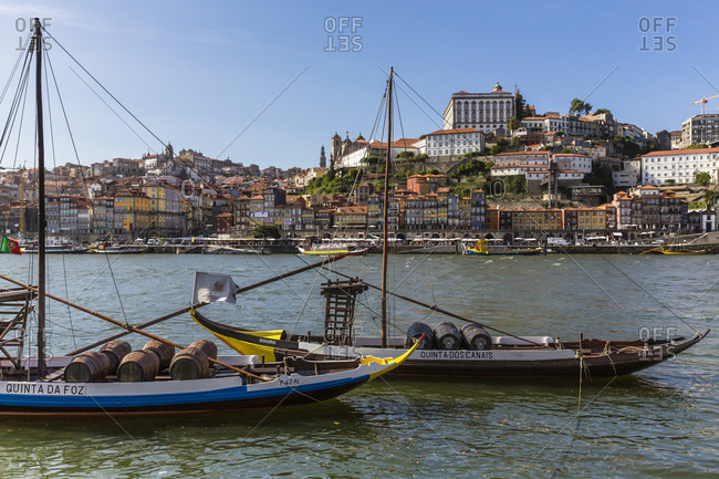 May 18, 2015: Traditional port wine boats on the Douro River in front of the old town Cais da Ribeira, historic district, Cais de Gaia, UNESCO World Heritage Site