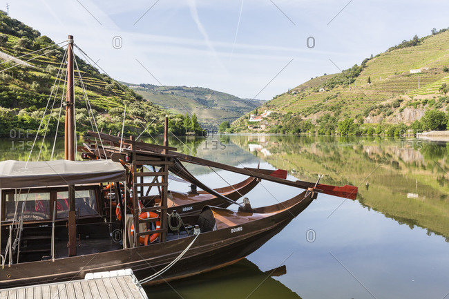 May 20, 2015: Tourist sightseeing boats, former port wine boats, on the Douro River at the village of Pinhao, UNESCO World Heritage