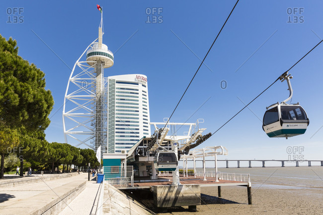 May 21, 2015: Chairlift in front of the Vasco da Gama Tower and bridge, Parque das Nacoes, Oriente district