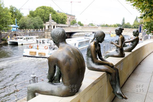 June 13, 2019: Three girls and a boy, group of figures, bronze figures, memorial, Berlin, Germany