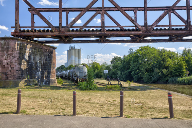 July 16, 2018: Industrial site, railway wagon, closed, Aurora, mill, silo, old Wesermühle, Hameln, Lower Saxony, Germany, Europe