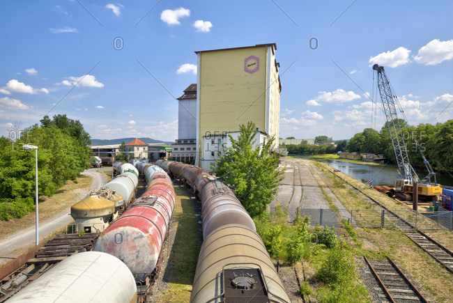 July 16, 2018: Industrial site, Aurora, mill, silo, old Wesermühle, Weser, mirroring, Hameln, Lower Saxony, Germany, Europe
