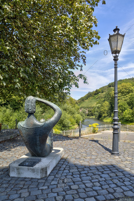 July 26, 2018: Sculpture, Mundenia, The Looking One, Fulda, River, Schlagdspitze, Hann. Menden, Lower Saxony, Germany, Europe