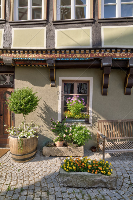 July 4, 2018: House facade, bench, truss, floral decoration, summer, old town, Hann. Menden, Lower Saxony, Germany, Europe