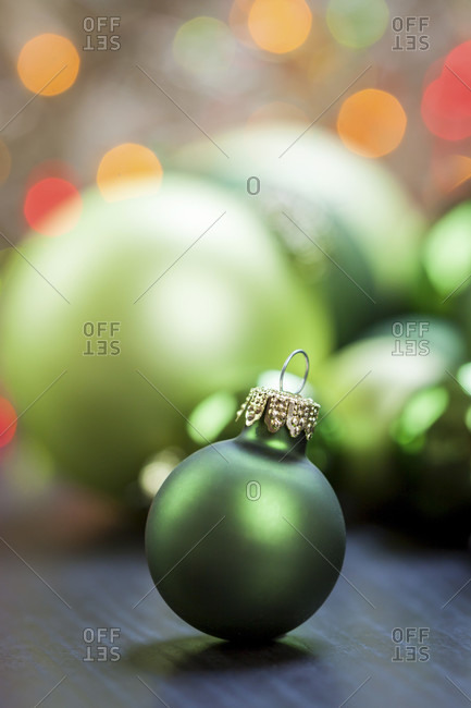 Colorful Christmas background of themed green baubles in assorted sizes and shades in a full frame close up view