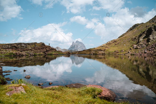 Hiker in a calm lake in Pyrenees
