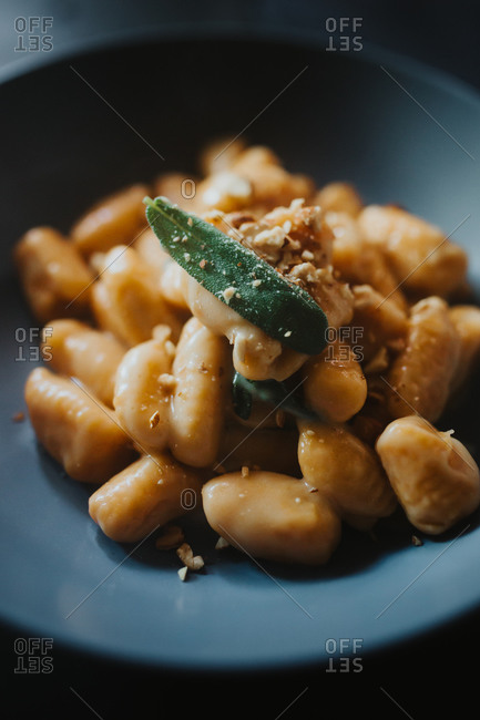 Freshly cooked gnocchi in a creamy butter and sage sauce with crushed hazelnuts and grated parmesan cheese