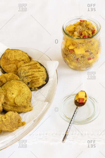 Plate of deep fried vegetables with mango chutney