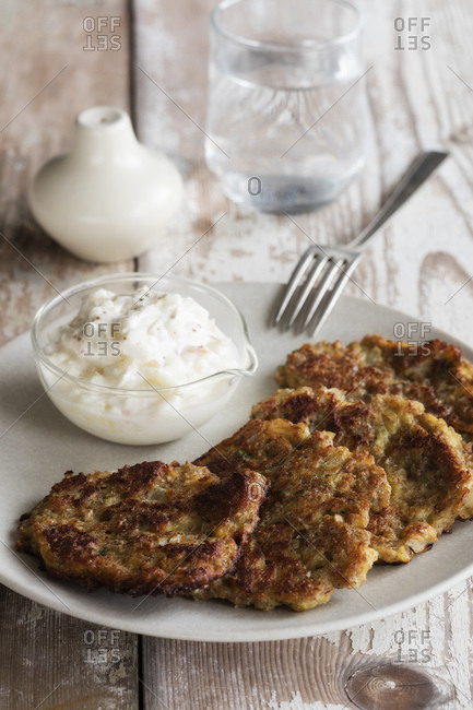 Rye and turnip pancakes with sour cream-yogurt dipping sauce