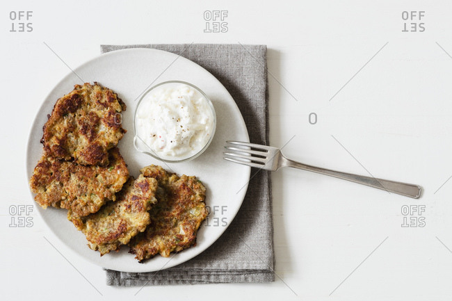 Studio shot of rye and turnip pancakes with sour cream-yogurt dipping sauce