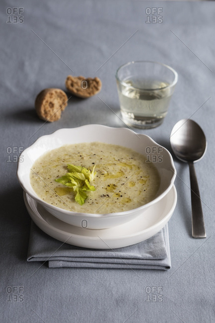 Bowl of vegetarian cream soup with oats and celery