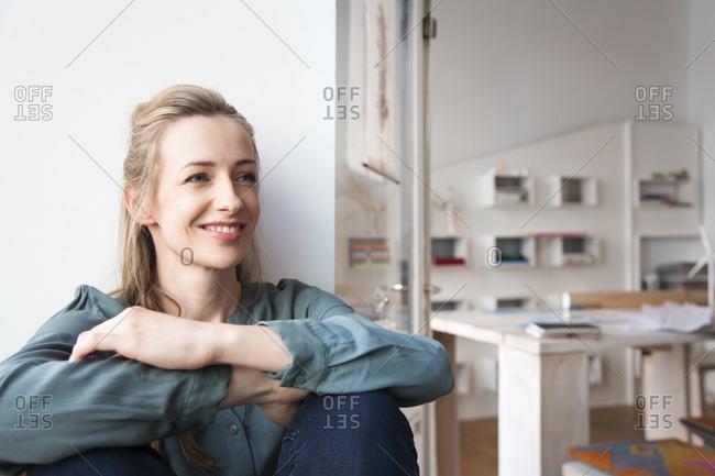 Smiling woman having a break in home office