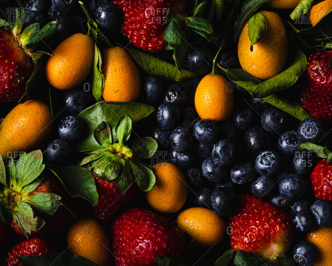 Full frame of blueberries- strawberries and kumquats