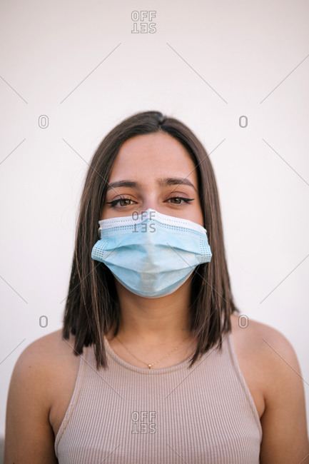 Portrait of beautiful young woman wearing protective face mask
