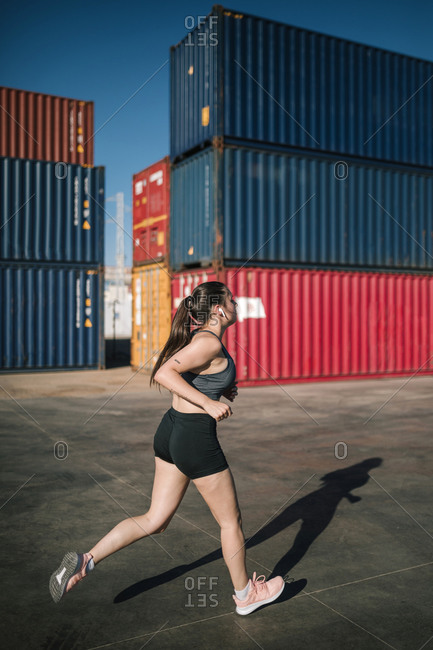 Woman jogging in an industrial park