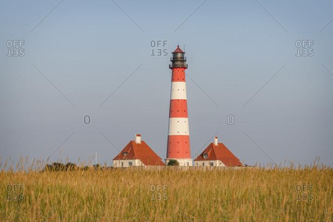 Germany- Schleswig-Holstein- Westerhever- Grassy field in front of Westerheversand Lighthouse