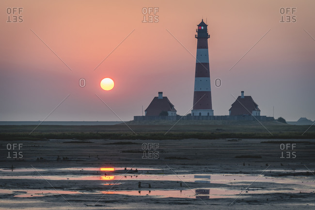 Germany- Schleswig-Holstein- Westerhever- Westerheversand Lighthouse at sunrise