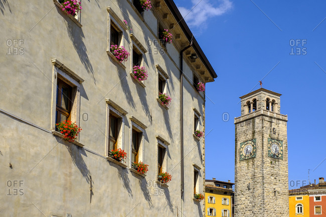 Italy- Trentino- Riva del Garda- Windows of old town hall with Torre Apponale clock tower in background