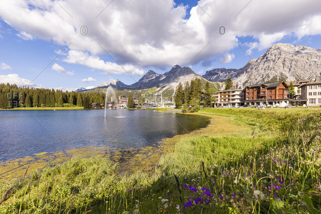 Switzerland- Canton of Grisons- Arosa- Shore of Obersee lake in summer with town in background