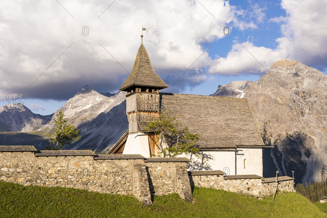 Switzerland- Canton of Grisons- Arosa- Stone wall in front of Bergkirchli in summer
