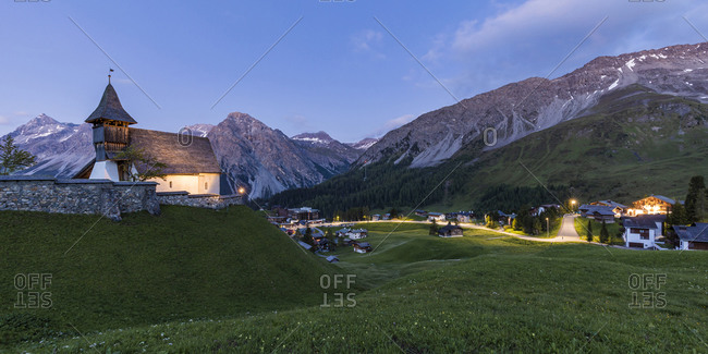 Switzerland- Canton of Grisons- Arosa- Panorama of Plessur Alps and alpine town at summer dusk
