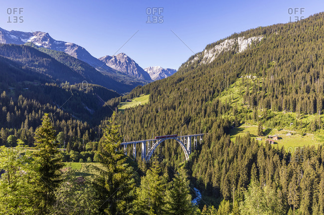 Scenic view of Langwieser Viaduct and forested Plessur Alps in summer