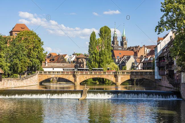 Germany- Bavaria- Nuremberg- Maxbrucke with old town buildings in background