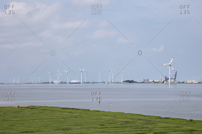Germany- Lower Saxony- Emden- Wind turbines on bank of Ems