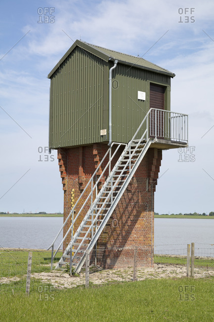Germany- Lower Saxony- Ditzum- Water level observation tower on bank of Ems