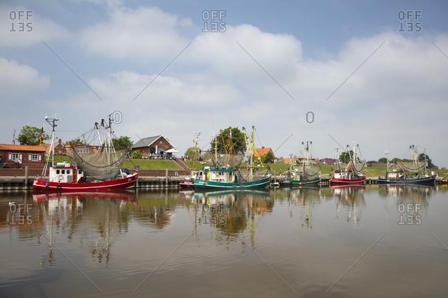 June 13, 2020: Germany- Lower Saxony- Krummhorn- shrimp boats moored in Greetsiel
