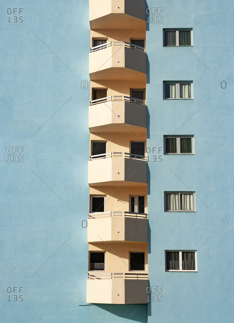 Balconies of pastel blue colored hotel