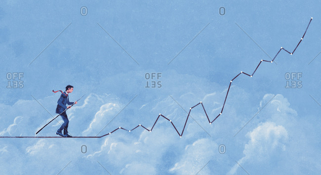 Businessman walking along graph as tightrope in sky