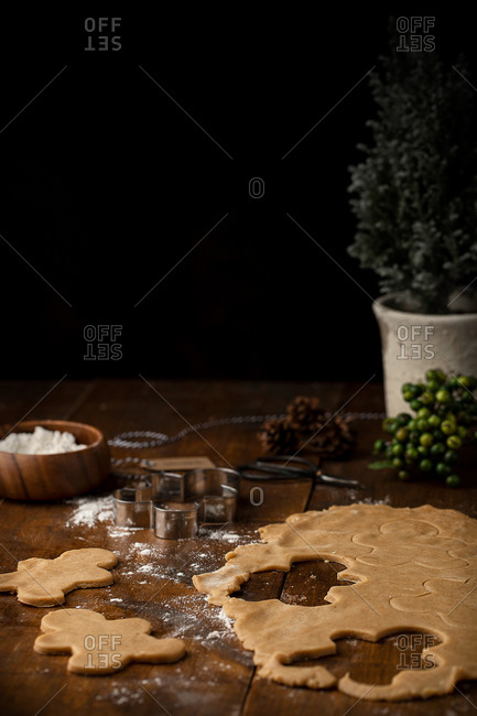 arrangement of raw dough for gingerbread and cookie cutter on table prepared for cooking dessert for Christmas party