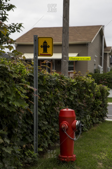Quebec - September 1, 2020: A fire hydrant and sign in Longueuil, Quebec, Canada