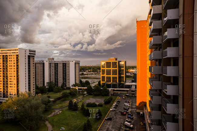 Dramatic sunset light over condominiums and offices in Longueuil, QC, Canada