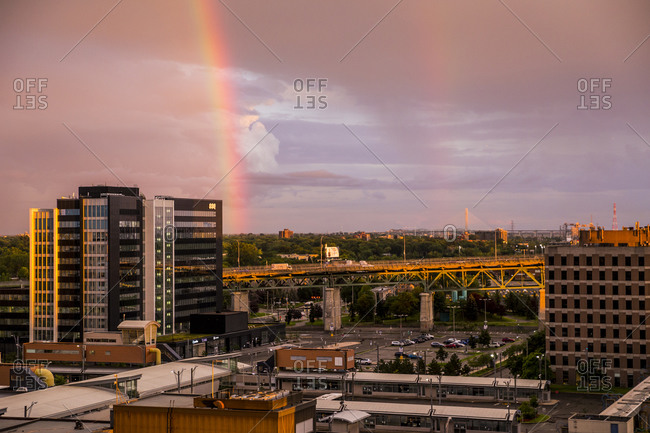 A rainbow over buildings in Longueuil, QC, Canada