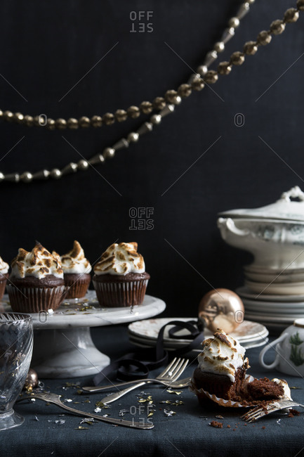 Chocolate cupcakes with marshmallow meringue on a party table