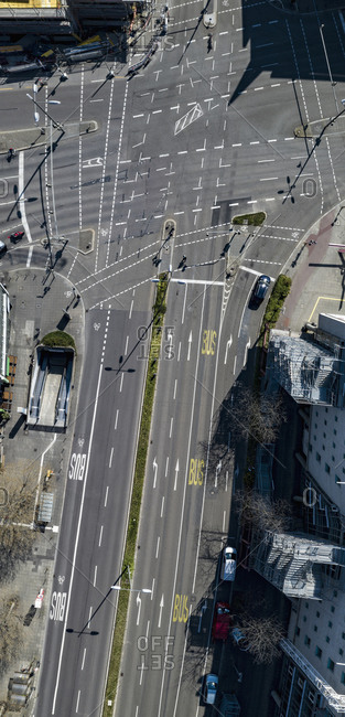 Aerial view sunny intersecting city streets, Stuttgart, Baden-Wuerttemberg, Germany