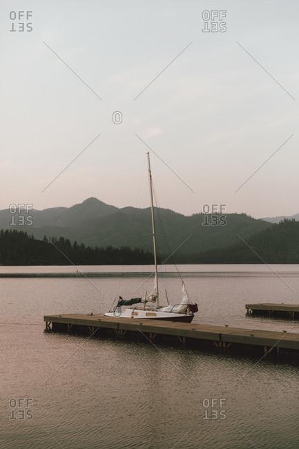 Sailboat moored at dock on tranquil Whiskeytown Lake, Redding, California, USA