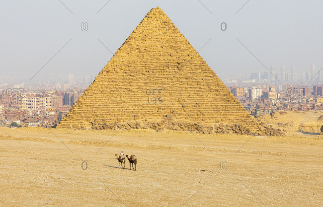 Giza pyramid and cityscape on sunny day, Cairo, Egypt