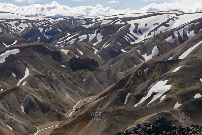 Snow patches on scenic mountain landscape, Iceland