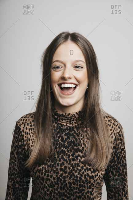 Portrait of happy young brunette woman