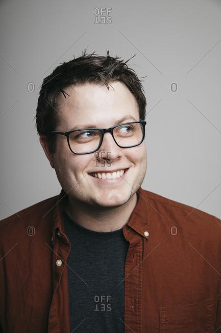 Portrait of eager man in eyeglasses looking away