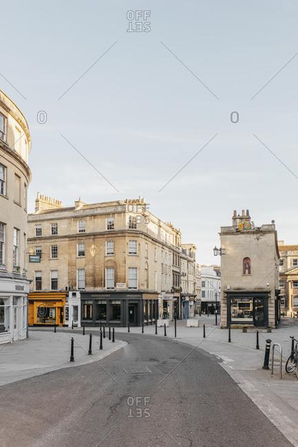 Buildings along empty curving road, Bath, Somerset, UK